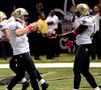Drew Brees of the New Orleans Saints with Devery Henderson breaking Johnny Unitas record
